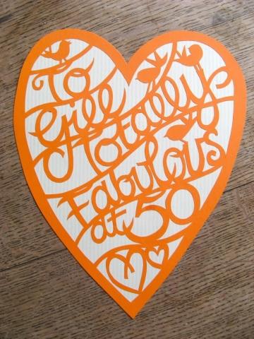 Hand cut paper cut heart